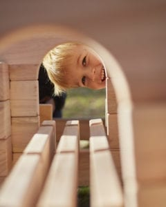 Child looking through Notch Block Tunnel